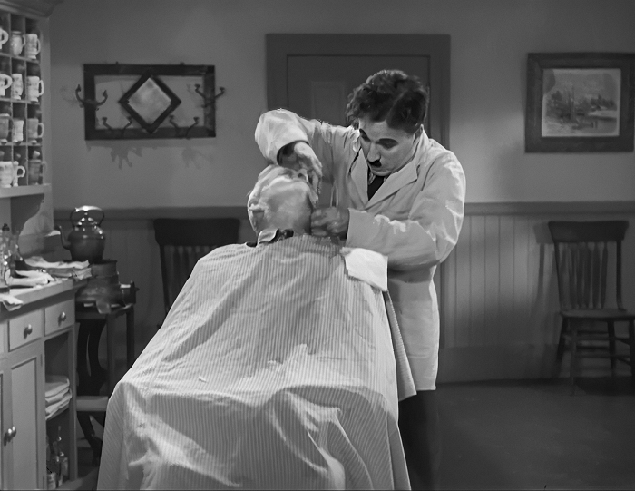 chaplin as the jewish barber giving a shave